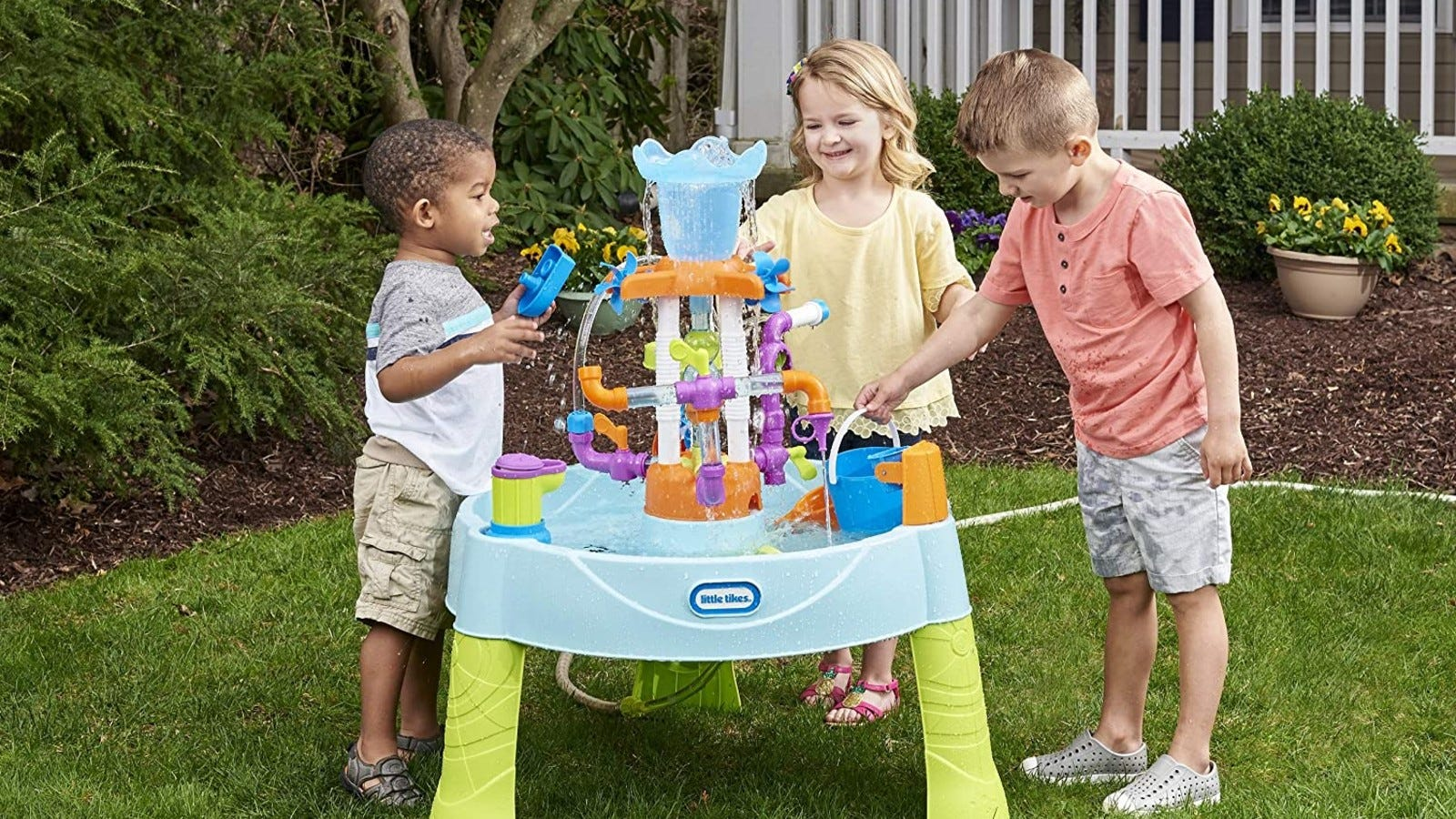 blue water table with three kids standing around it playing