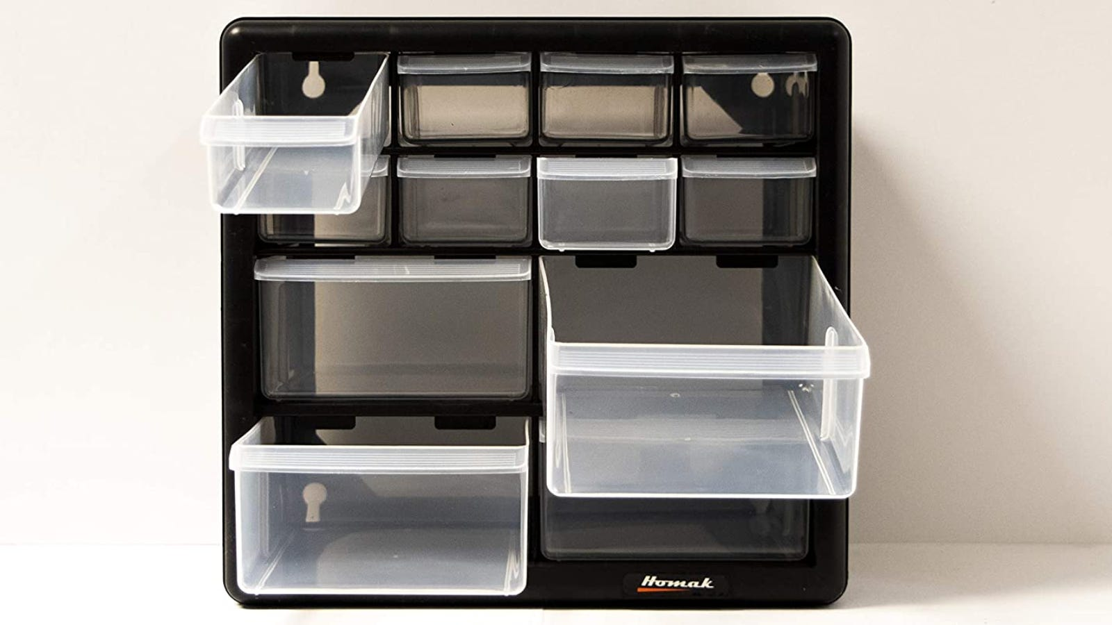 A teacher toolbox that features four large drawers and eight small drawers.