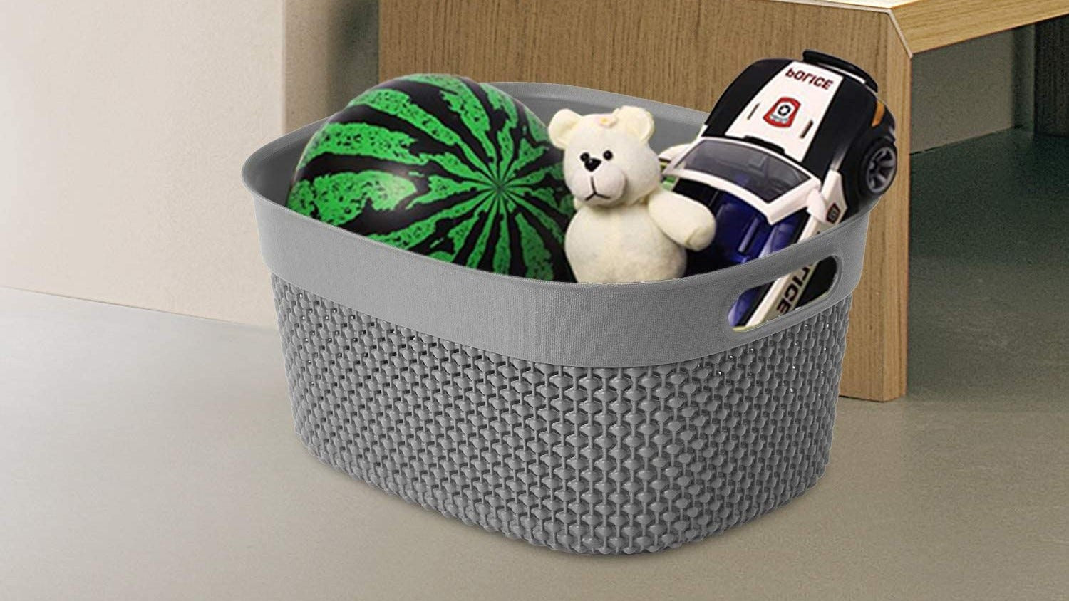 Cute curved plastic basket with toys inside.
