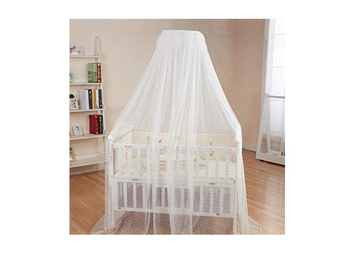 hanging white mesh tent canopy closed over crib