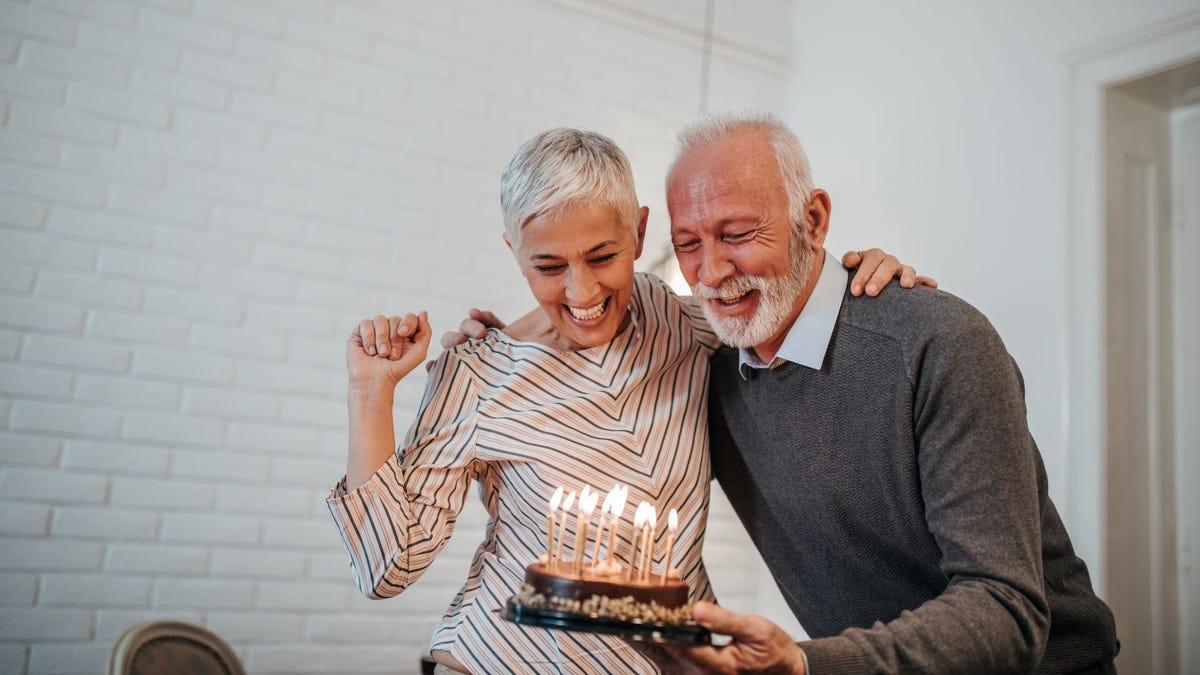 A mature couple celebrating a birthday.