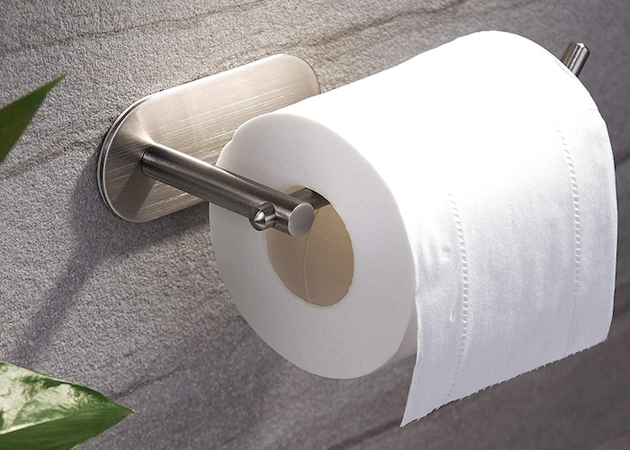 classic chrome single bar toilet paper holder with one open end, supporting a standard roll of toilet paper