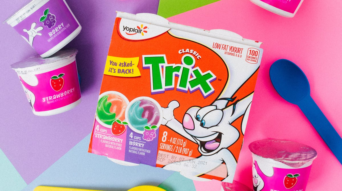 An eight-pack of Trix yogurt surrounded by three individual cups.