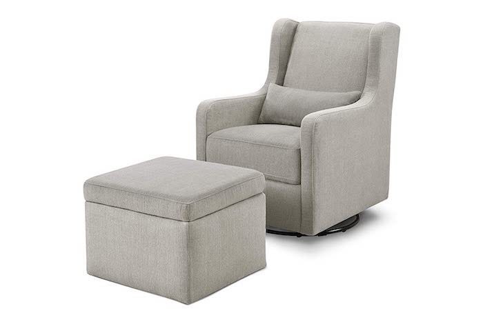 square, pale gray, fully upholstered nursing chair and with a matching storage ottoman and small back cushion