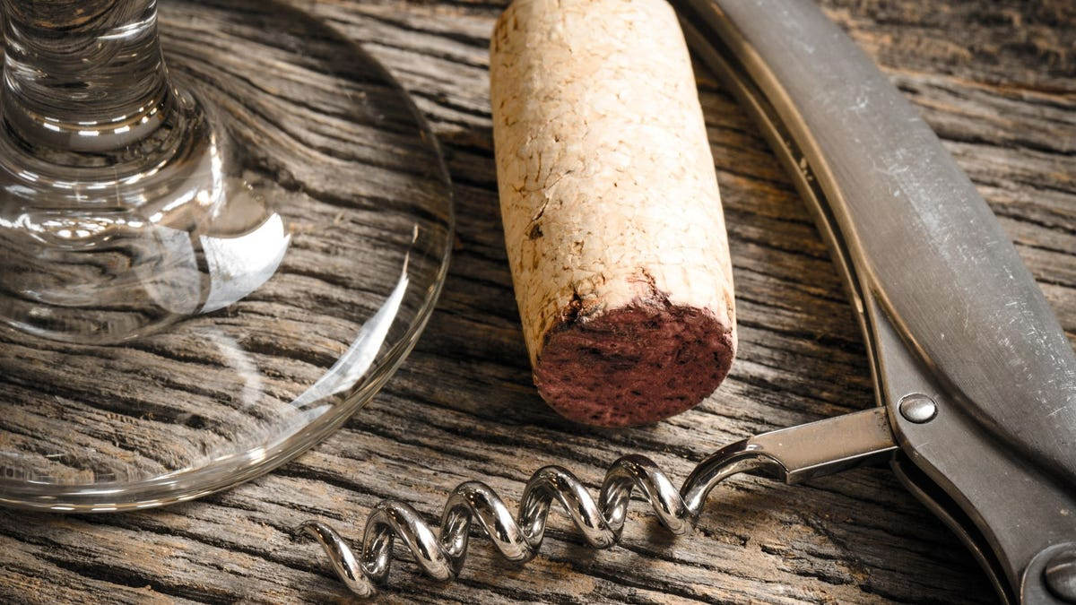 A wine cork and bottle opener.