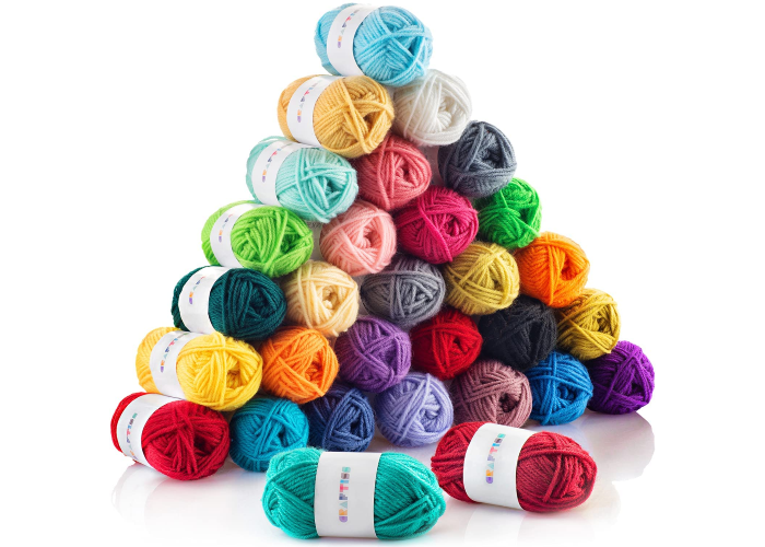 A pile of 30 yarn skeins in different colors