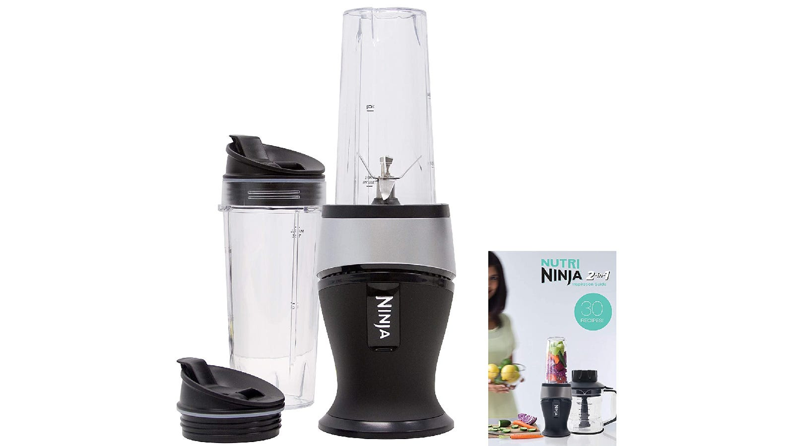 personal blender with a black base and clear blender cup; to the left is an extra blender cup with two black lids, and to the right is a blender instruction manual