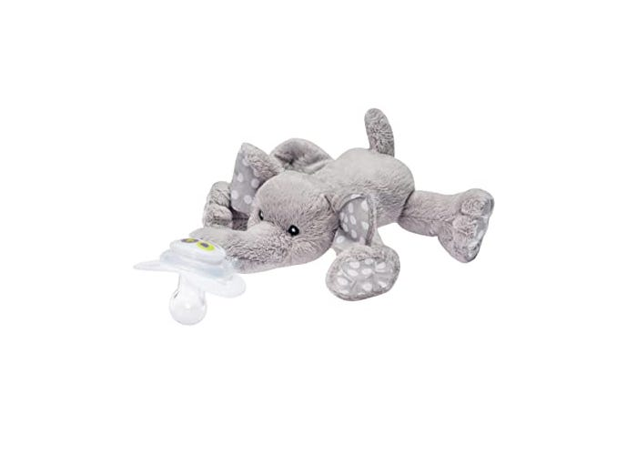 A light gray elephant toy with pacifier attached to trunk.