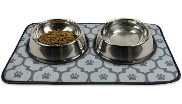two food bowls sitting on top of a thick mat