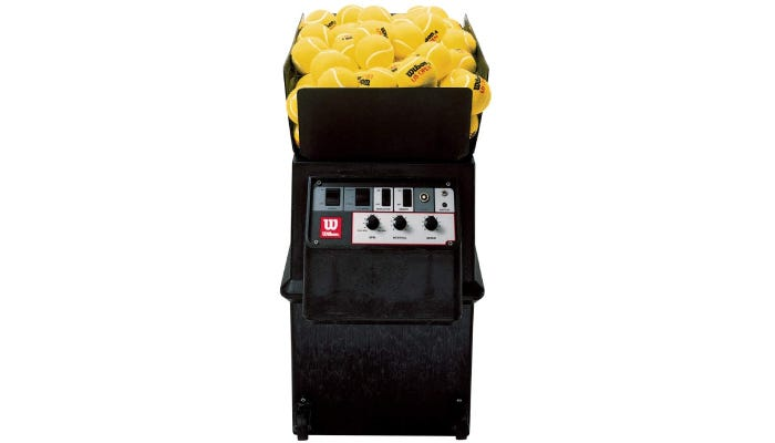 A Wilson tennis ball machine filled with yellow tennis balls is shown against a white background.