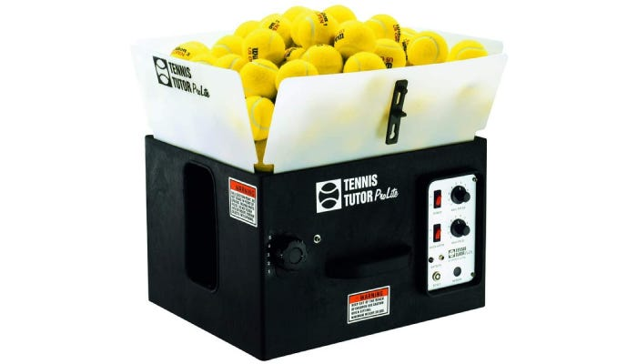 A black tennis ball machine filled with yellow tennis balls.