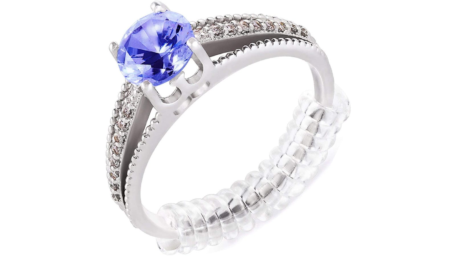 A silver ring that is fitted with a purple gem and a clear band size adjuster.