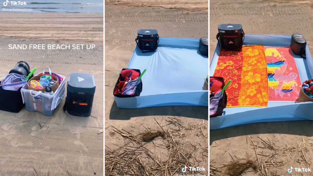 A fitted sheet held down by four coolers on a beach.