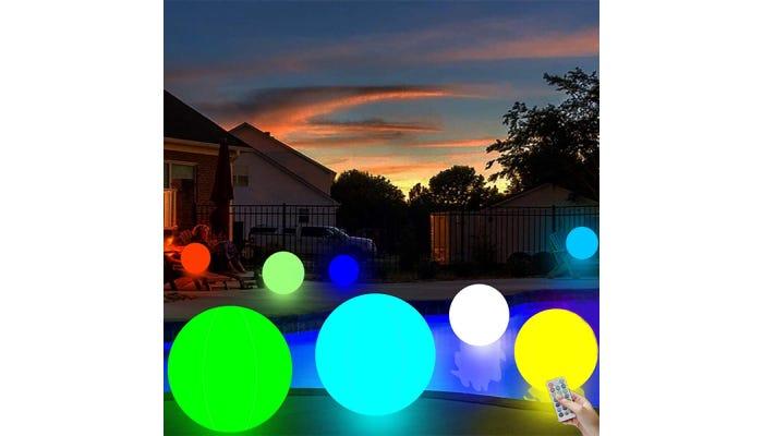 Several large illuminated colorful beach balls