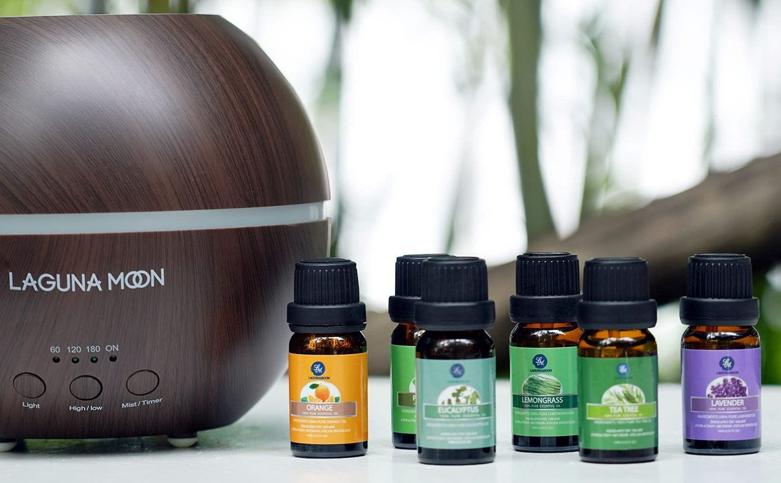 Six bottles of Laguna Moon essential oils next to the diffuser.
