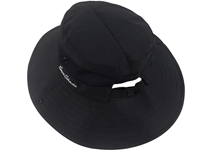A black fabric sun hat with adjustable pony tail slot.