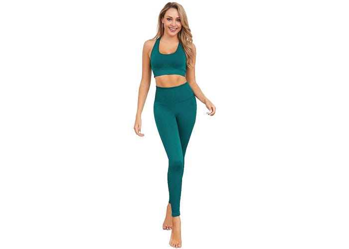 Blonde model in matching green high waisted leggings and sports bra.