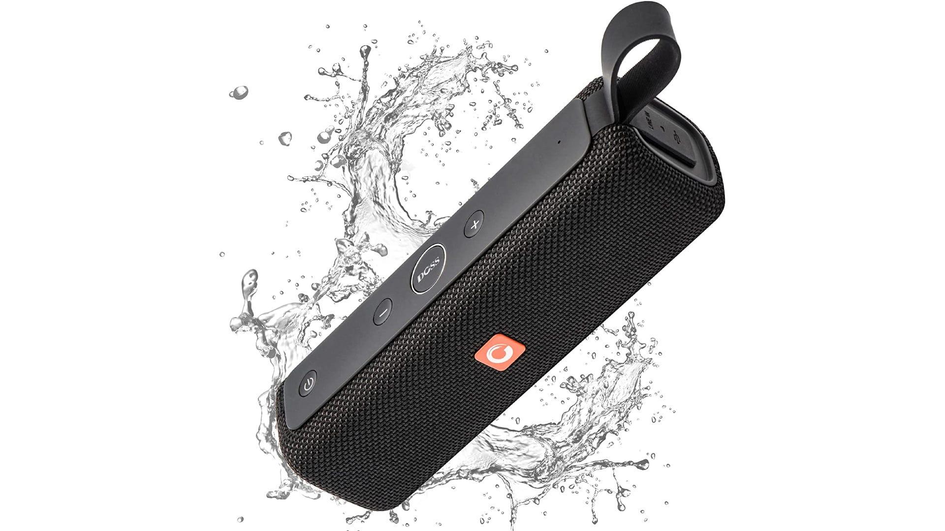 A rectangular black speaker with a finger strap splashes through water.