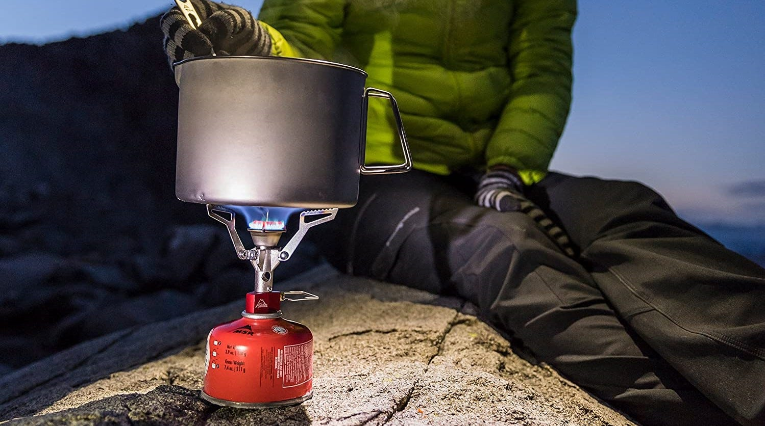 Someone cooking on an MSR PocketRocket Camping stove.