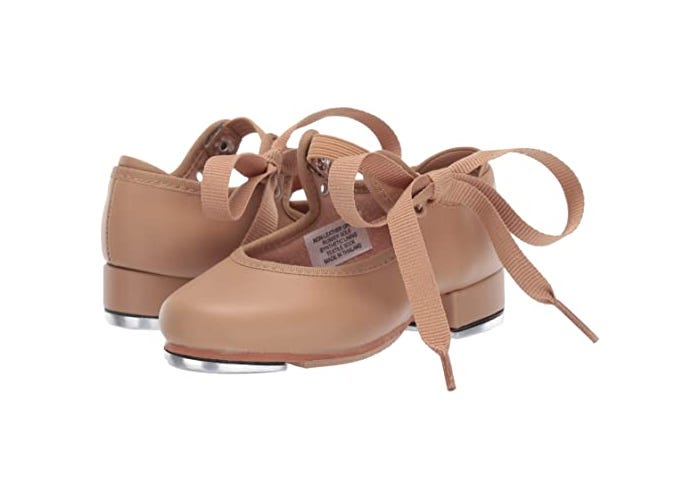 brown pair of little girls tap shoes with ribbons