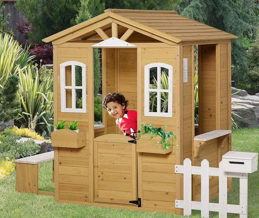 A child in the Outsunny Playhouse.