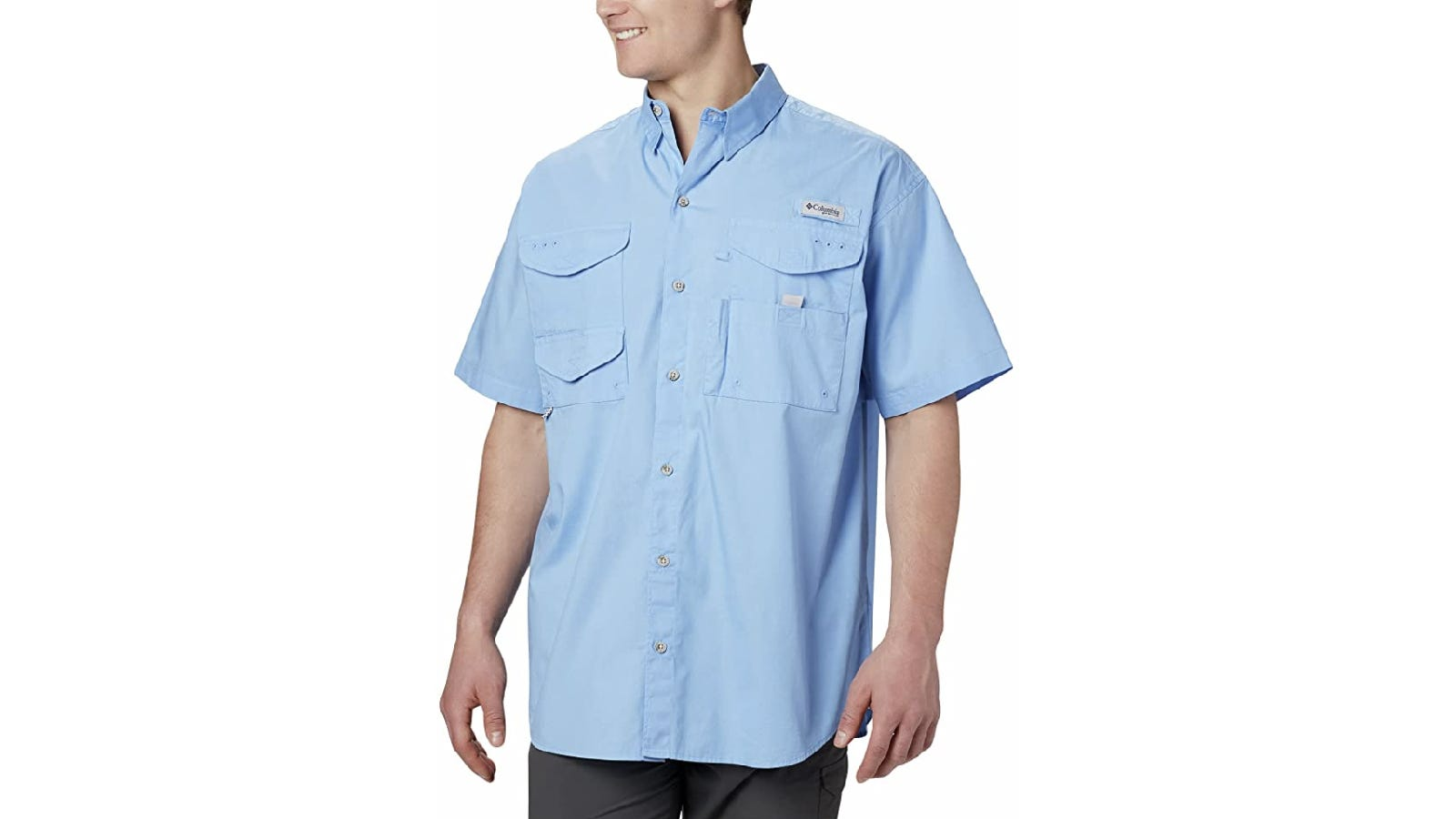 A model at centerframe lifts the top right pocket flap of a light blue button-up