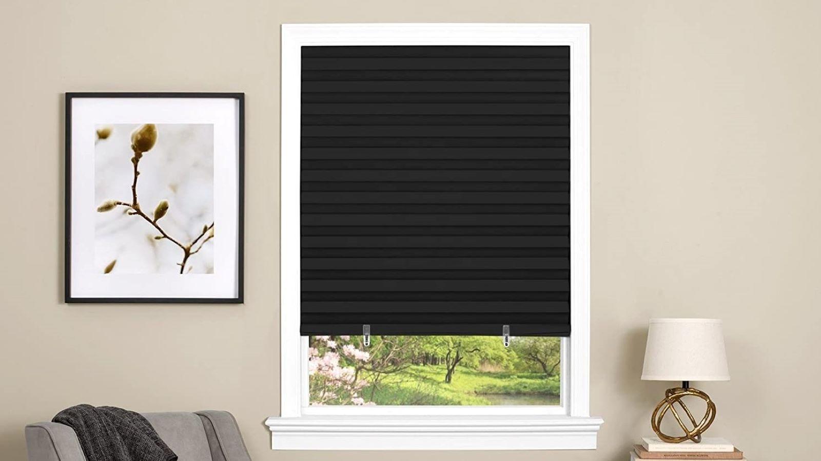 Achim Home Black Vinyl Room Darkening Pleated Window Shade on a window