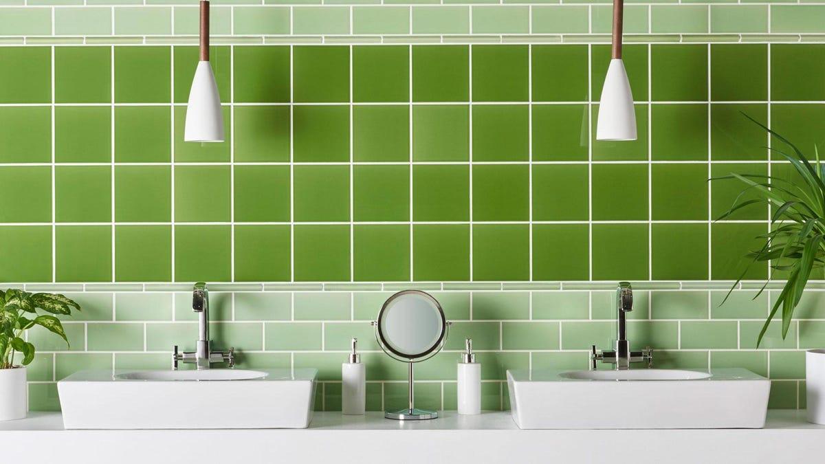 A bathroom tiled in green tilework.