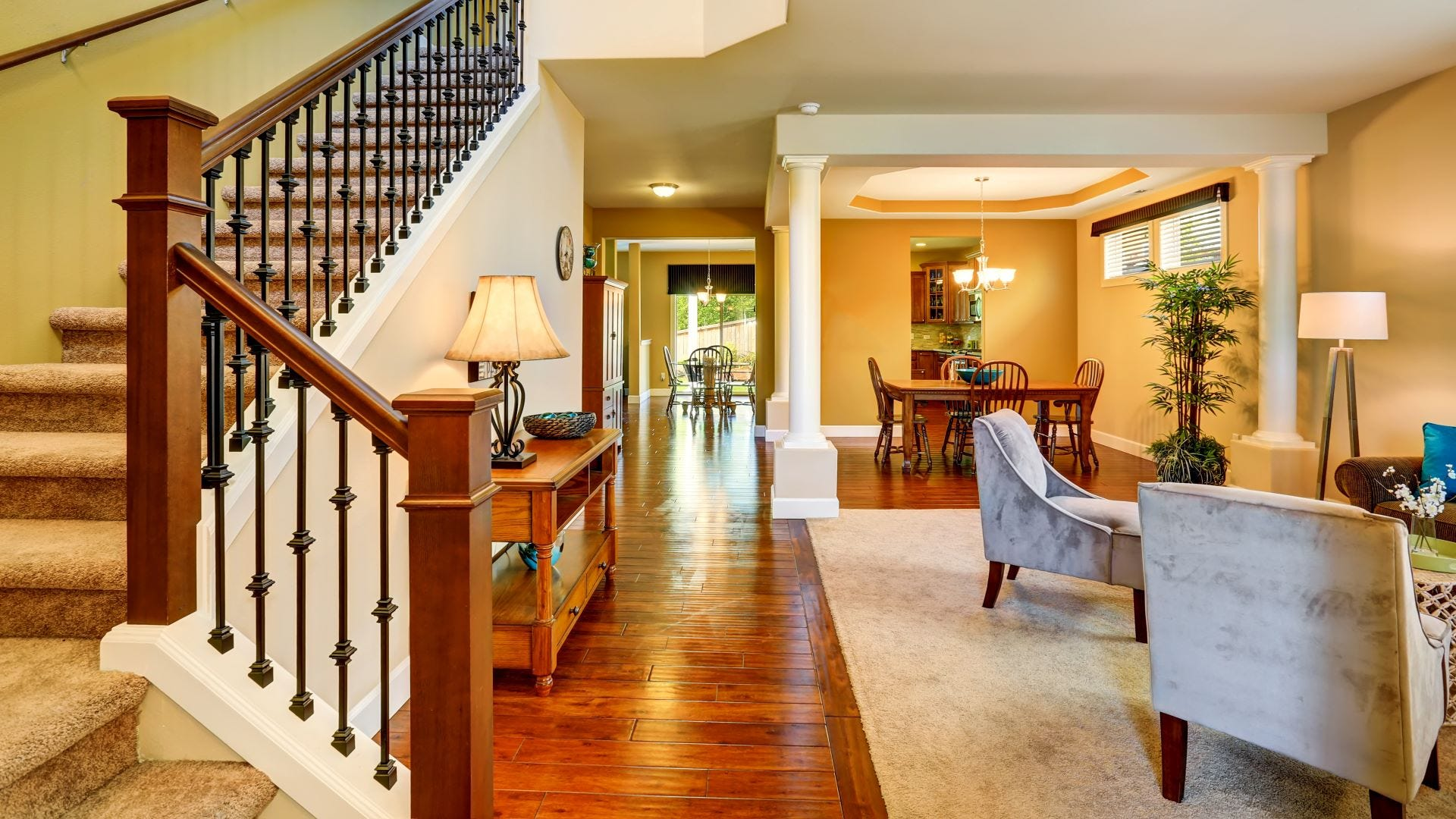 An open floor plan home with stairs.