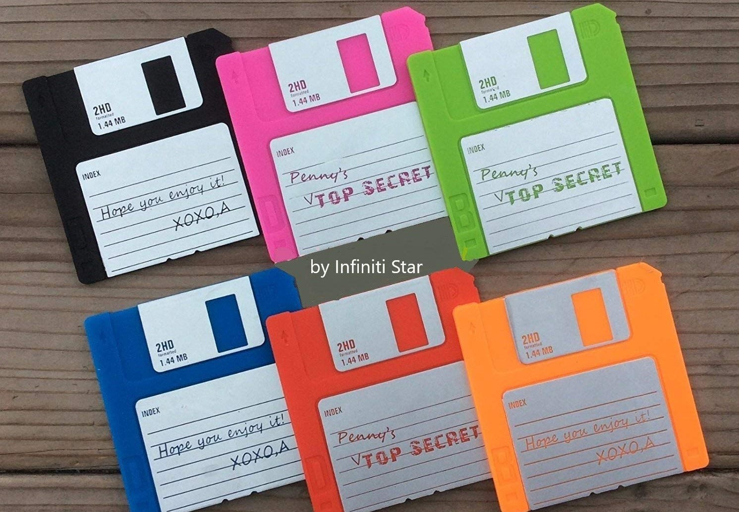 Six floppy disk coasters in various colors.