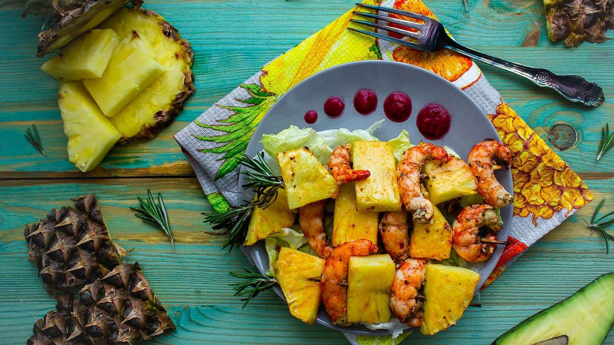 Grilled skewers with pineapple, seafood, and a sweet sauce.