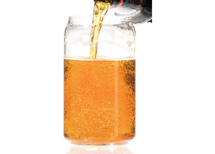 canned shape beer glass being filled with beer from bottle