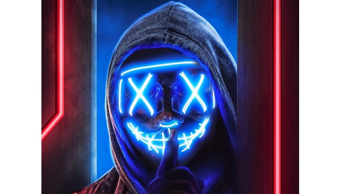 A person wearing a blue LED mask and a hood.