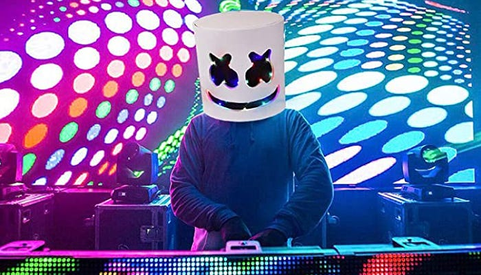 A person at a DJ table wearing a Marshmallow mask.