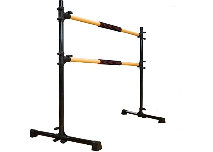A ballet barre with a black from and two wooden bars.
