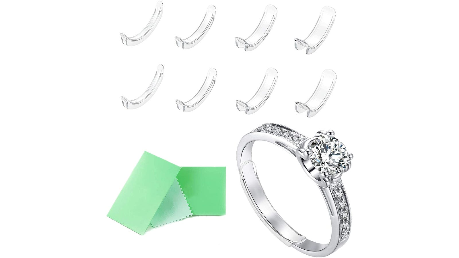 Eight clear ring adjusters above a silver diamond ring with a green cleaning cloth.