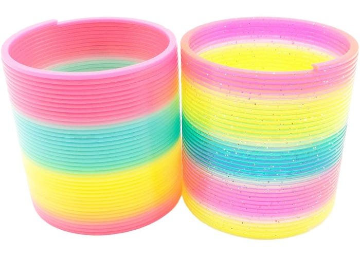 one neon and one glitter coil spring toy side by side.