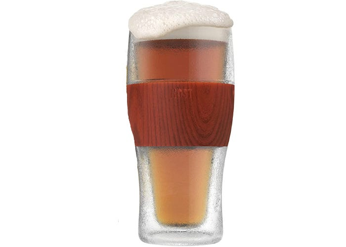 filled beer glass with a wood-toned hand grip