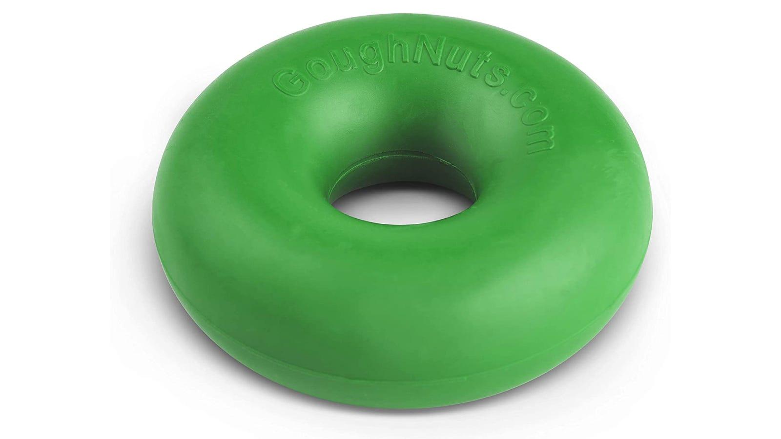 A green chew toy shaped like a doughnut.