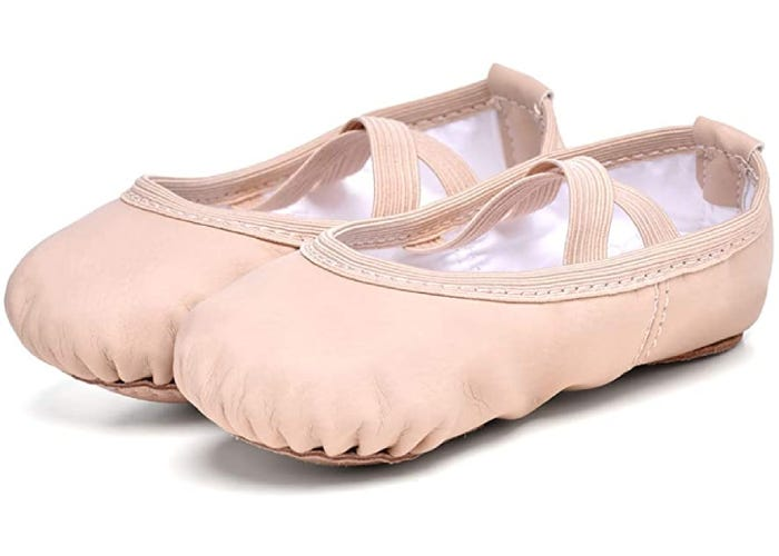 pair of light pink ballet shoes with elastic straps