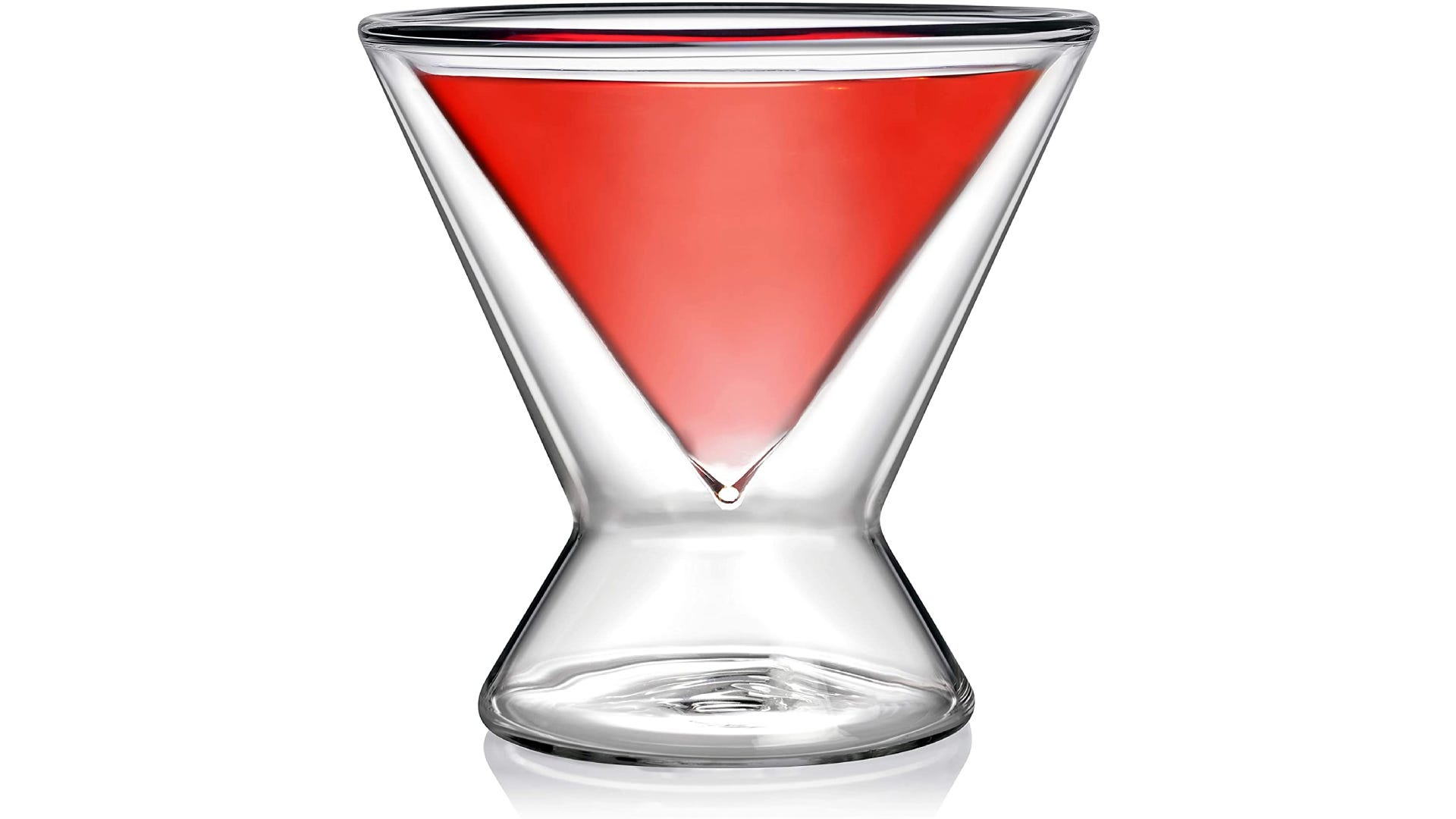 V-shaped glass with thick base, filled with red liquid.