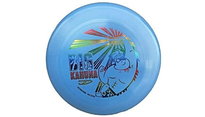 a big, blue frisbee with a rainbow, shiny stamp on front