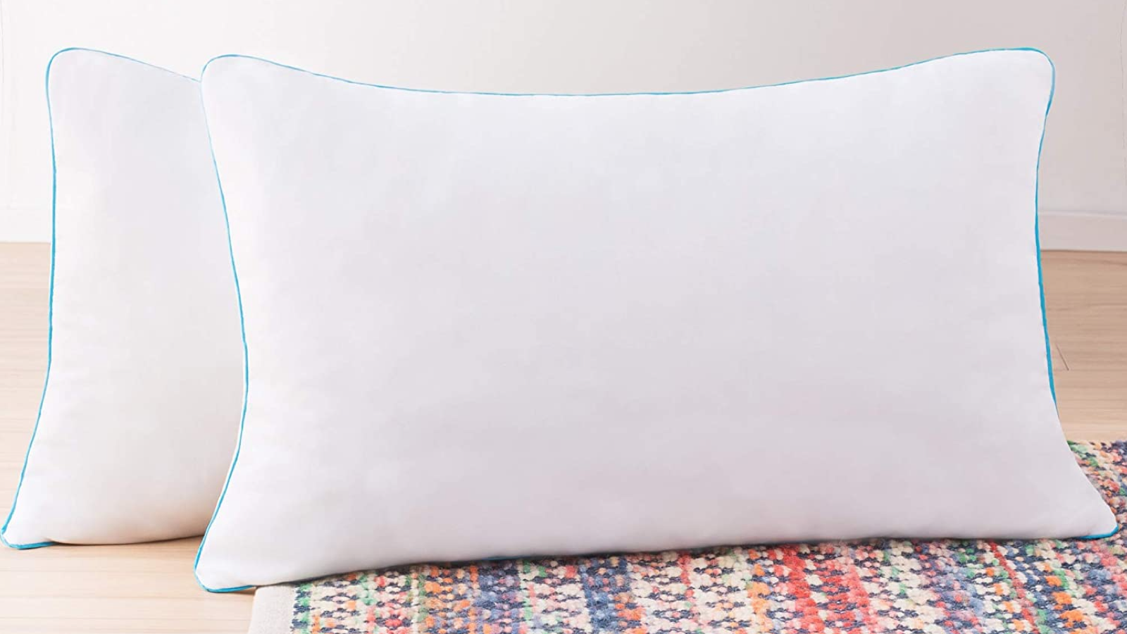 two memory foam pillows in white pillowcases