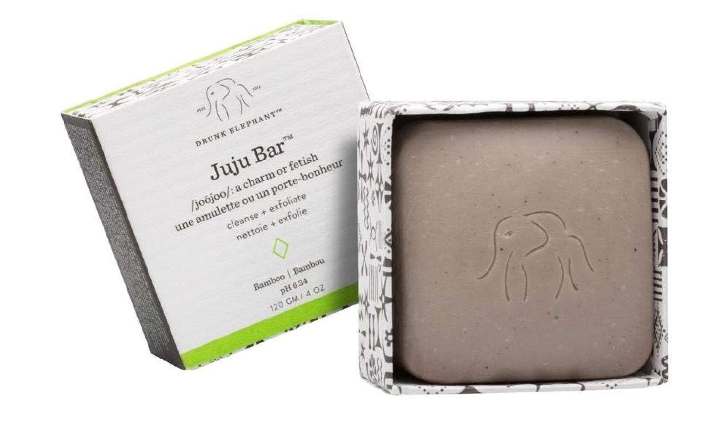 The JuJu Bar in its box next to the lid.