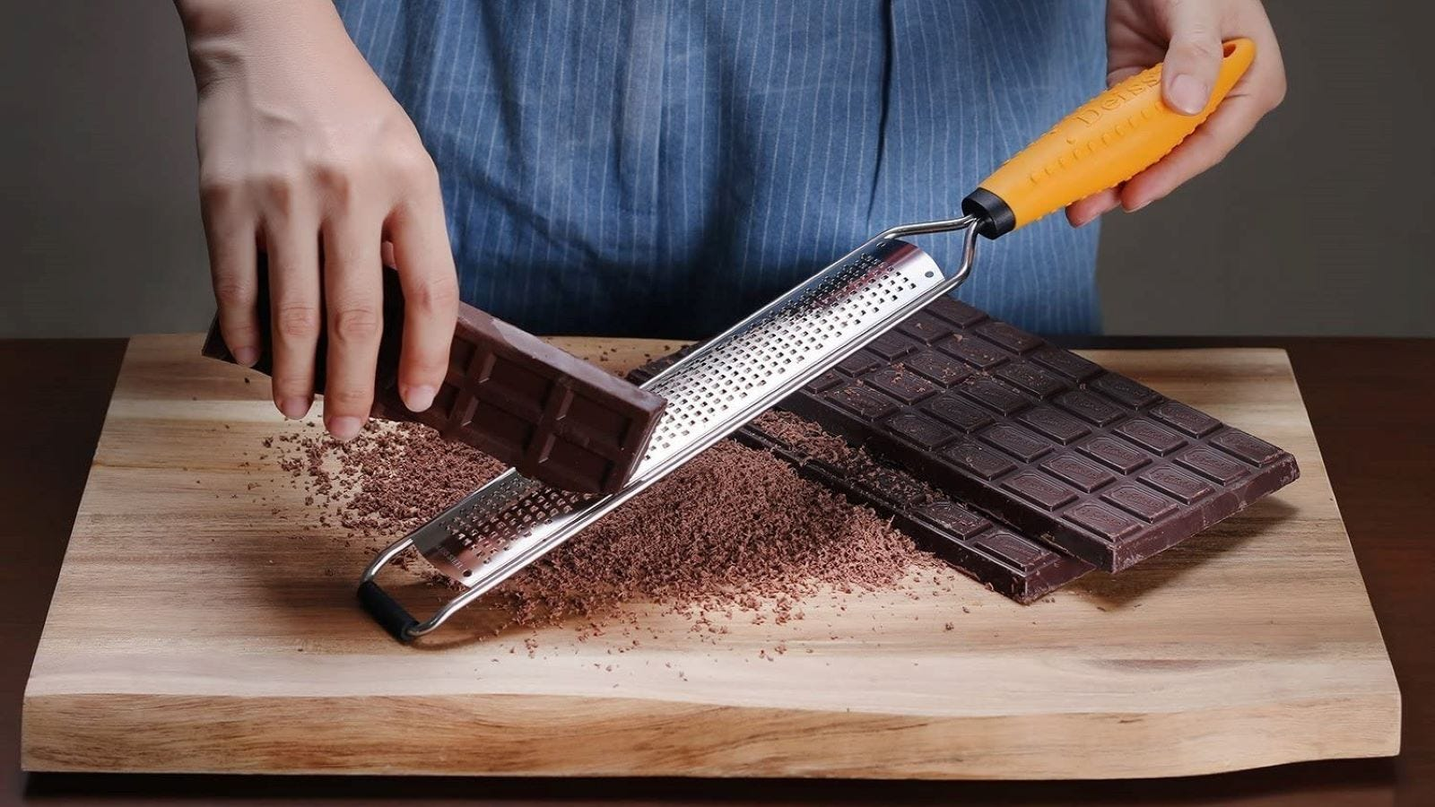 Someone grating chocolate on the Deiss PRO Citrus Zester.