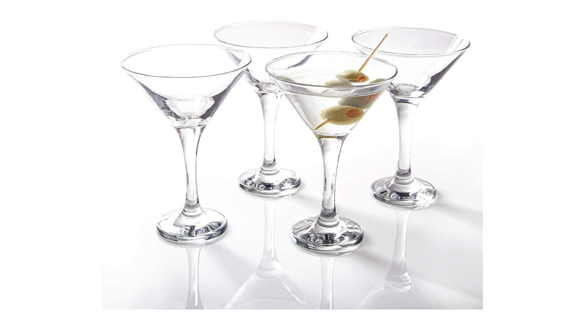 four Y shaped martini glasses made of clear glass, one with liquid and olives inside