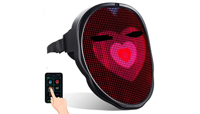 A LED face mask with a heart displayed on the front.