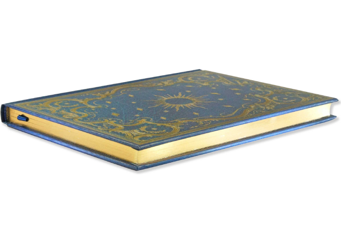 a celestial-patterned notebook with gilded gold edge pages