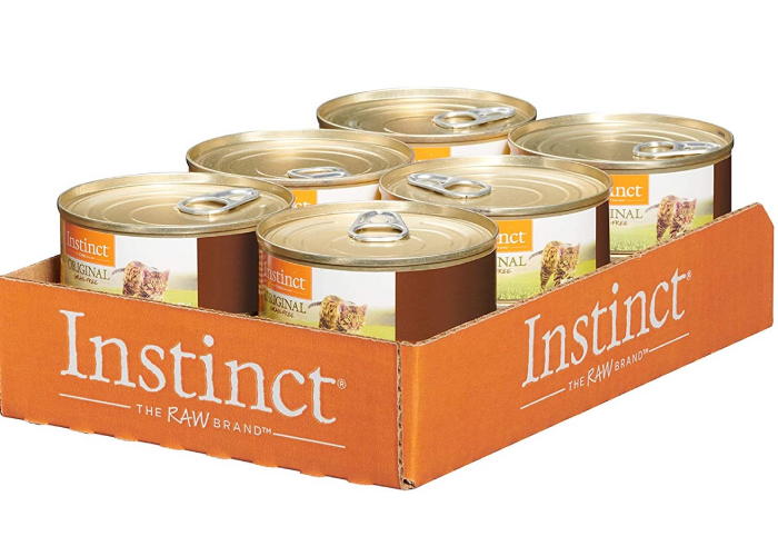 An orange container of six instinct raw inspired cat food cans.