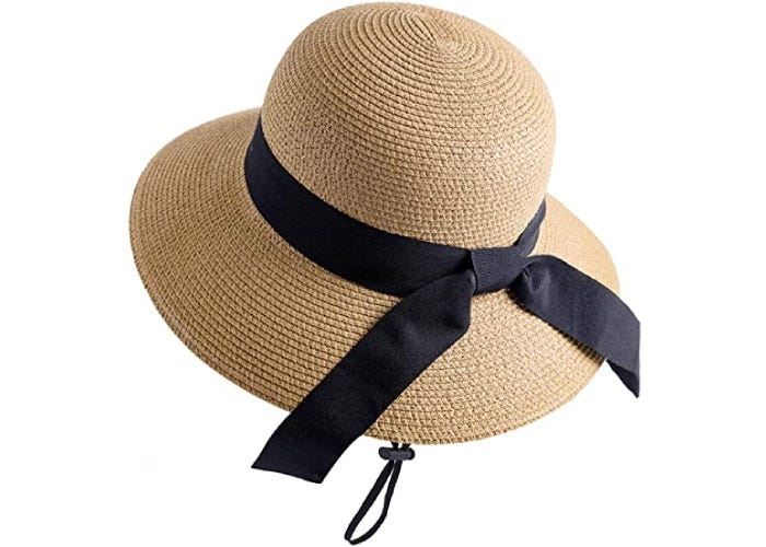 A straw hat with a black ribbon tied around the crown and a black chin drawstring.